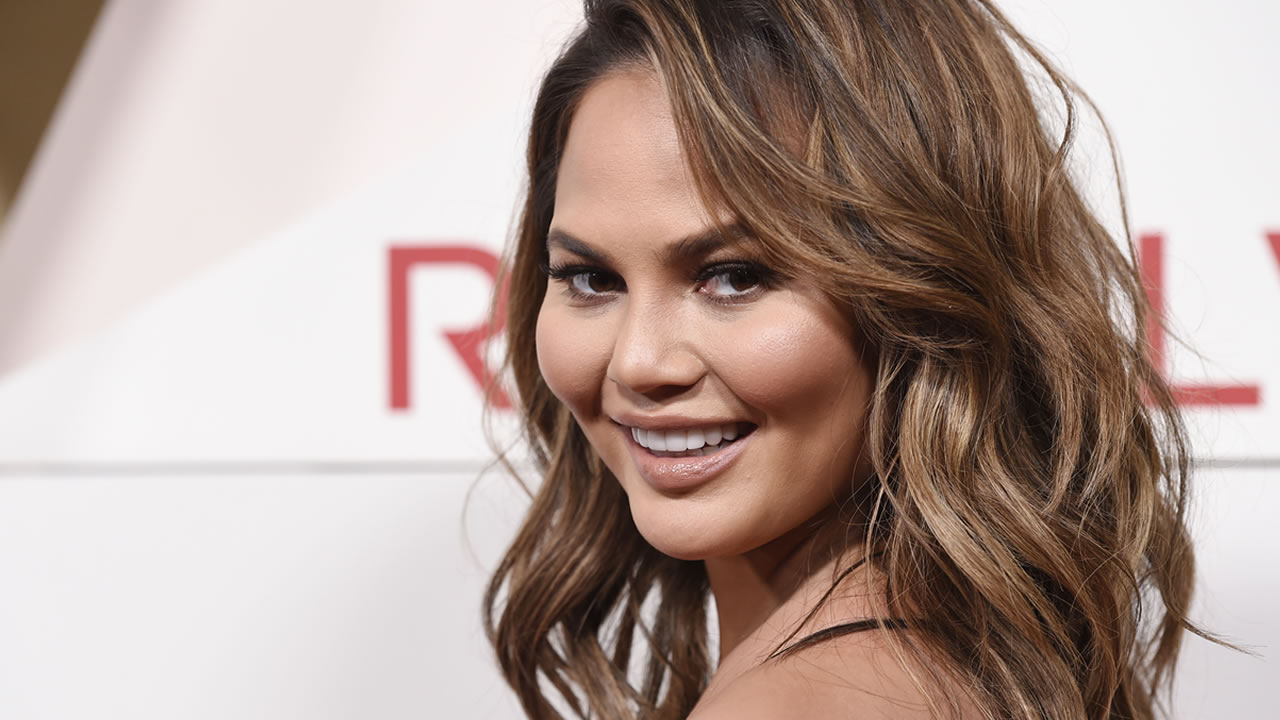 In this Nov. 2, 2017 file photo, model Chrissy Teigen poses at the 2017 Revolve Awards at the Dream Hollywood hotel in Los Angeles.
