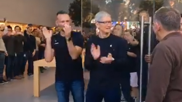 Tim Cook greets customers at the Apple store in Palo Alto, California on Friday, September 21, 2018.