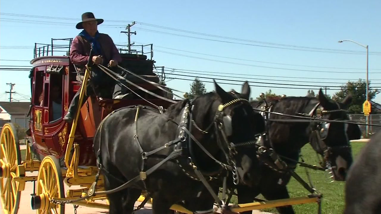 The Wells Fargo Stagecoach pulls up to a school in Richmond, Calif. on Friday, Sept. 21, 2018.
