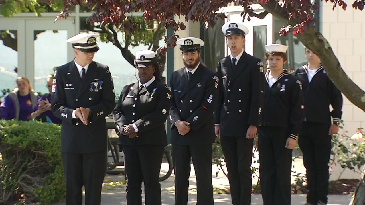 Members of a Sea Scouts crew accepted awards for helping save a mans life at a ceremony on Sept. 22, 2018, on Yerba Buena Island in San Francisco.
