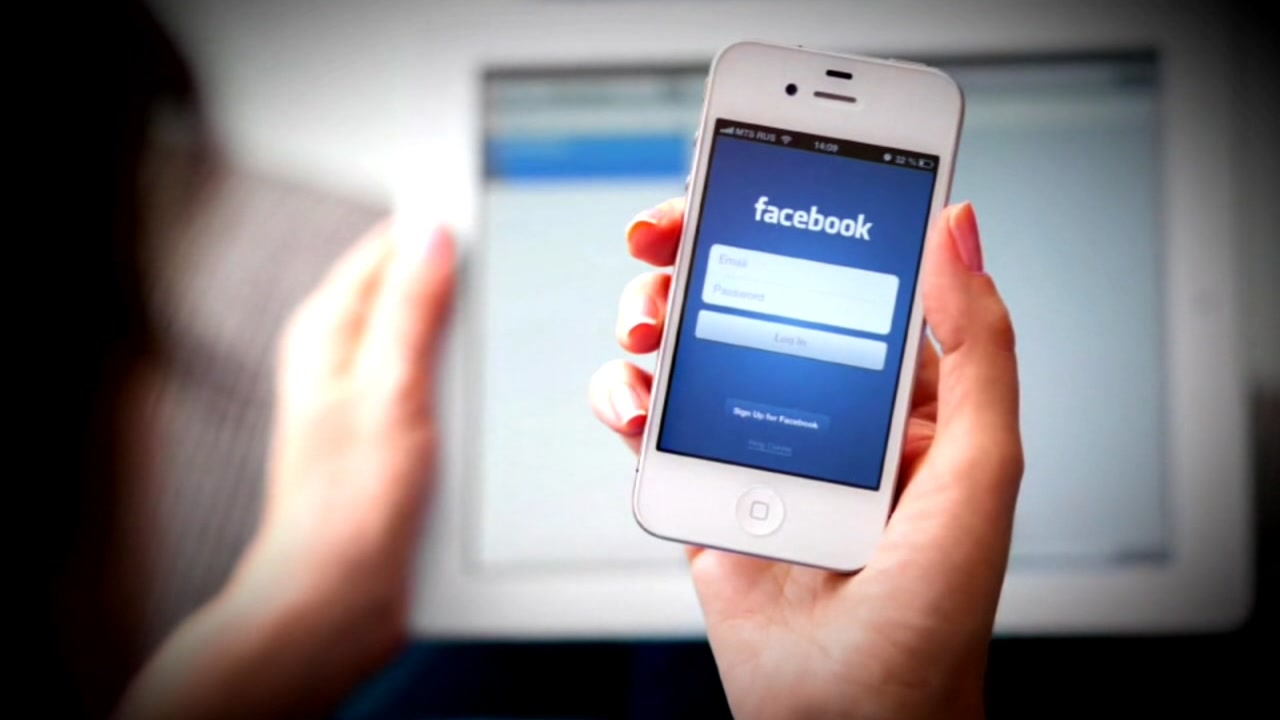 A person opens the Facebook app on their smartphone in this undated file photo.