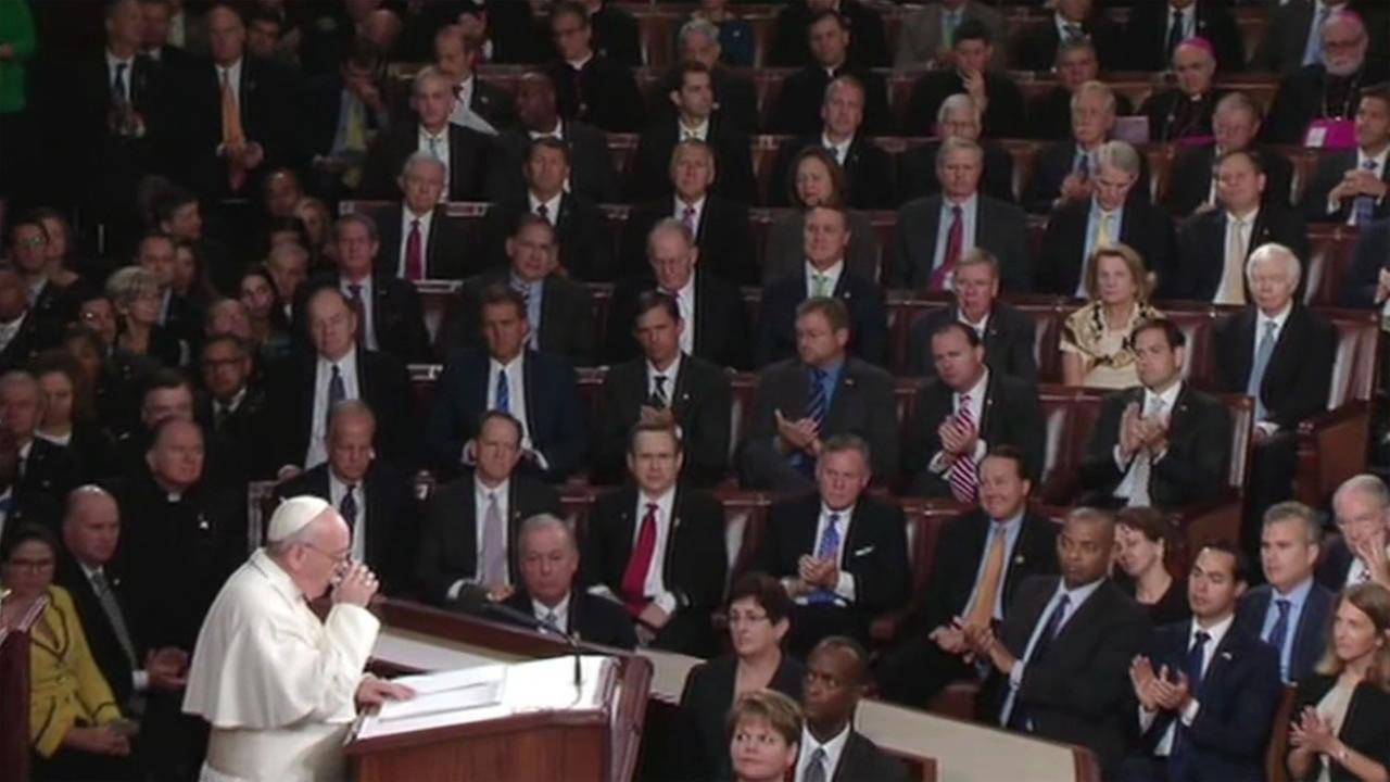 Pope Francis takes a sip of water as he addresses Congress Sept. 24, 2015.