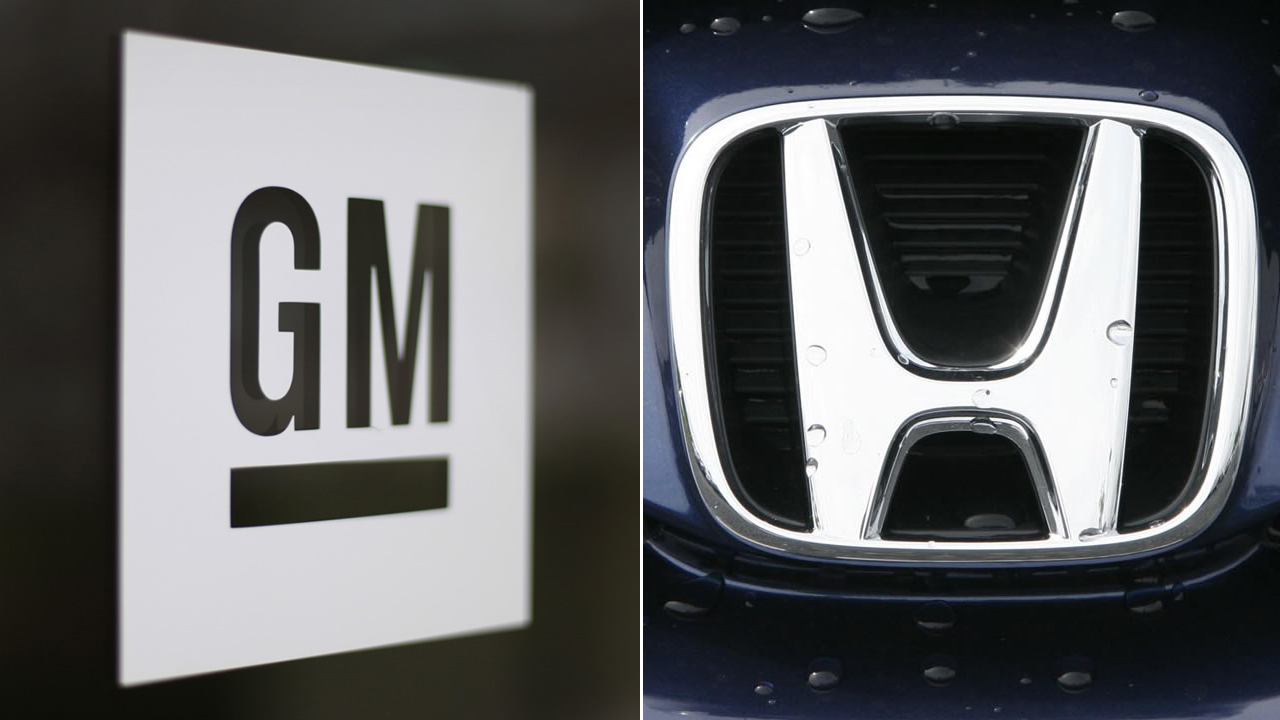 FILE -- General Motors and Honda logos