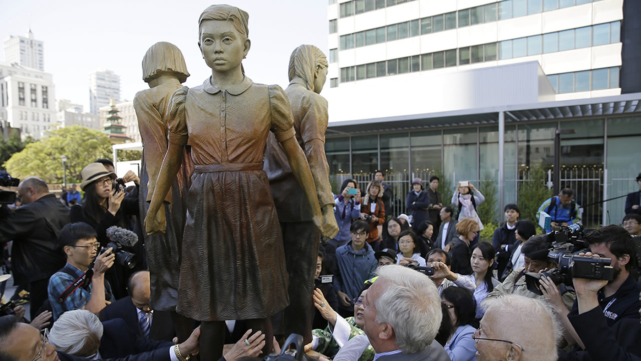 In this Friday, Sept. 22, 2017, file photo, people move in to take a closer look at the Comfort Women monument after it was unveiled in San Francisco.