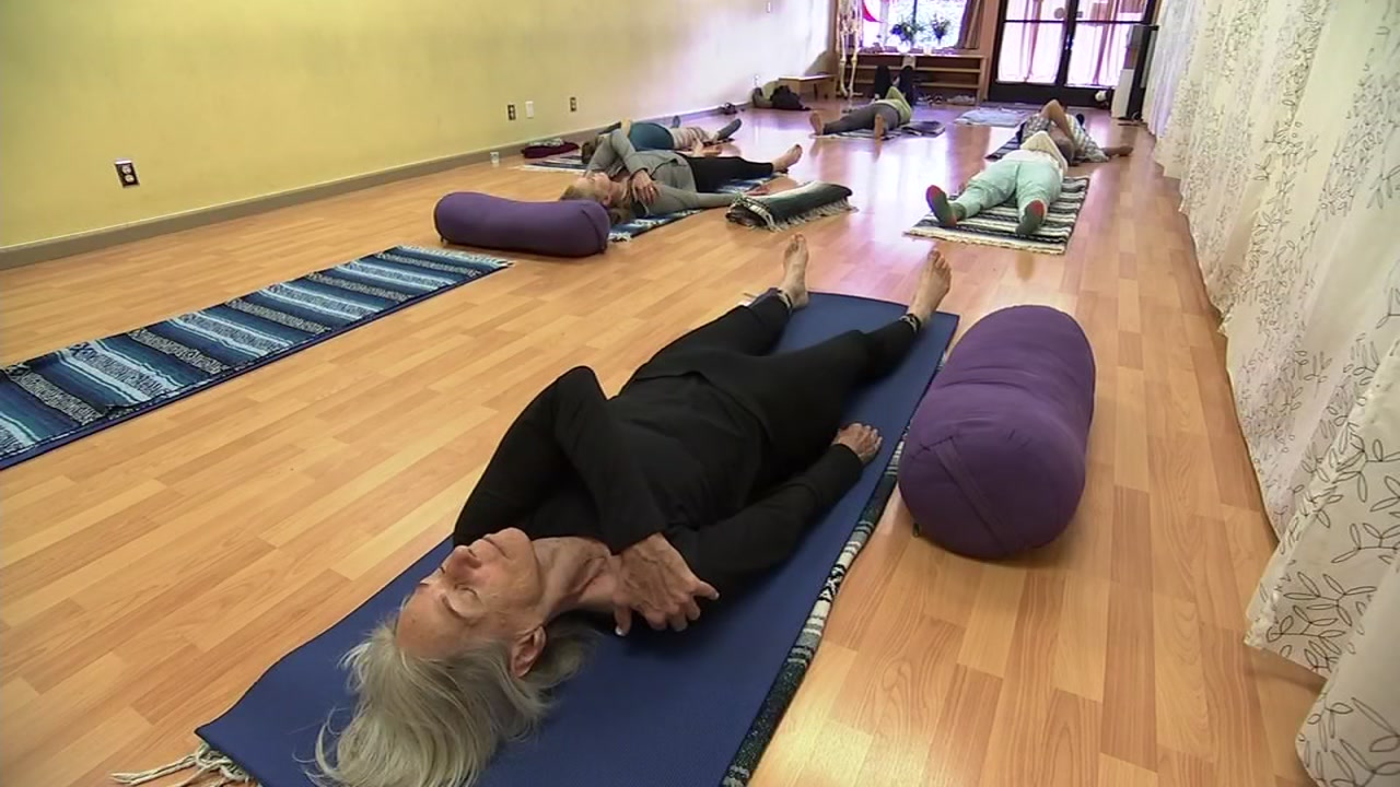 A North Bay Fire victim takes a yoga class offered by the Healthcare Foundation Northern Sonoma County on Thursday, Oct. 4, 2018.
