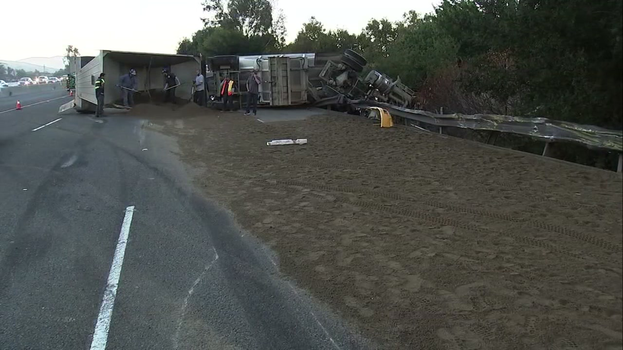 Big rig carrying 27 tons of concrete sand overturns on I-680 in Pleasanton, California on Friday, October 5, 2018.