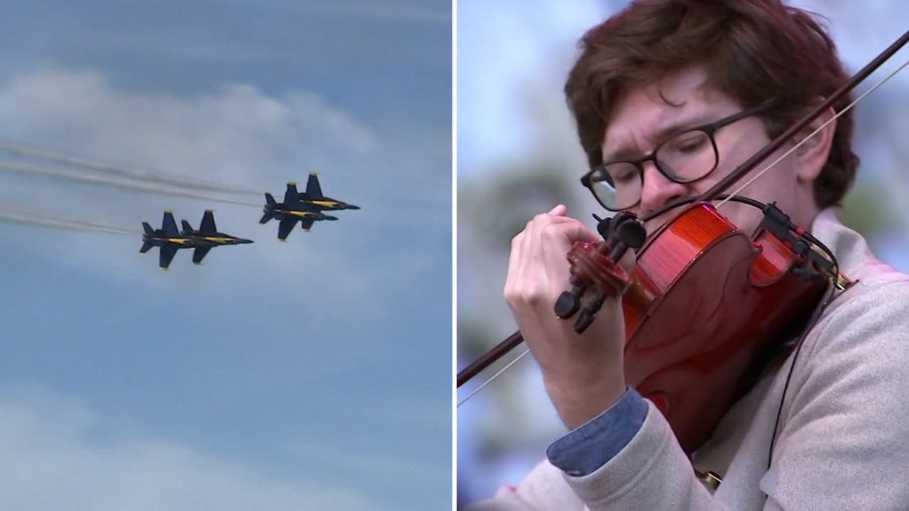 Planes fly over San Francisco during Fleet Week as musicians perform at the Hardly Strictly Bluegrass Festival in Golden Gate Park on Oct. 5, 2018.