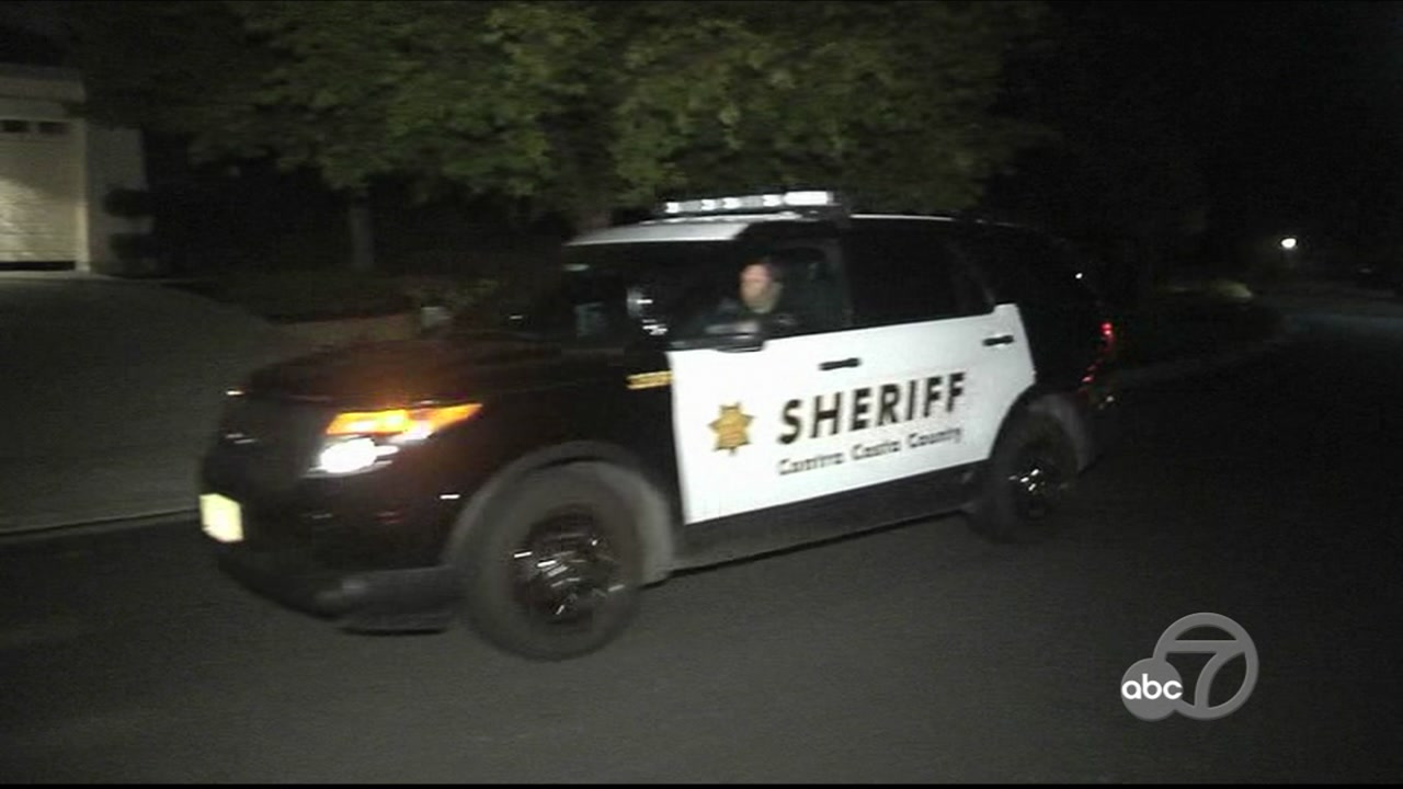 A Contra Costa County Sheriffs deputy pulls up to an Alamo, Calif. home on Thursday, Oct. 4, 2018.