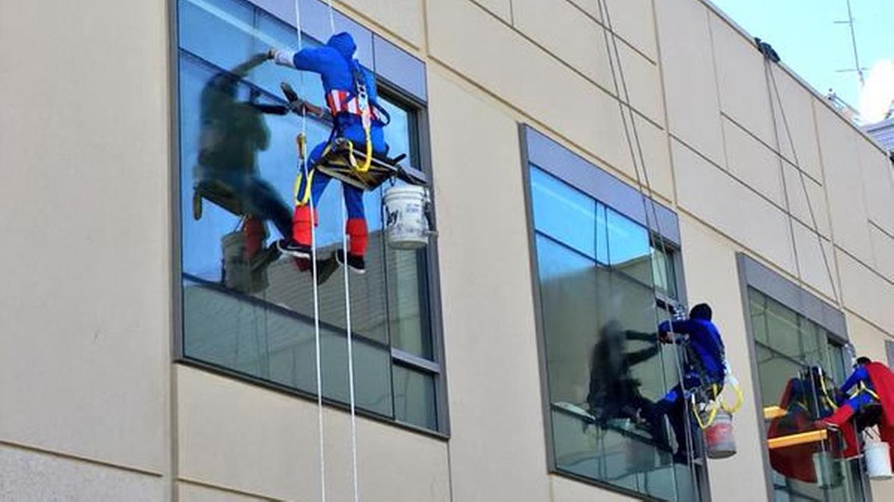 Window washers dressed as superheroes surprise sick children at UCSF Benioff Childrens Hospital in San Francisco on Monday, September 28, 2015.