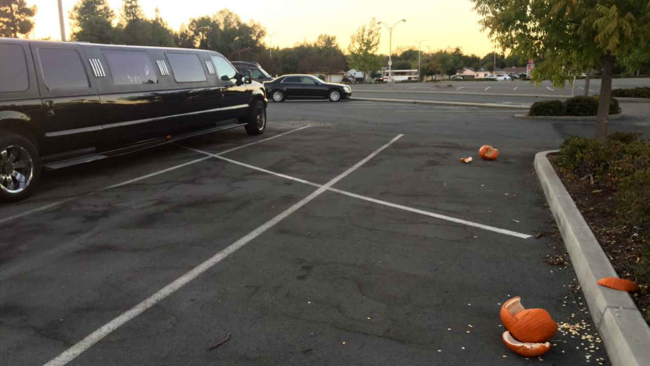 A smashed pumpkin is seen next to a limo in Concord, Calif. on Monday, October 8, 2018.