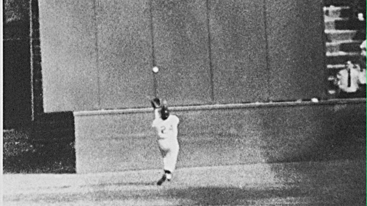 New York Giants Willie Mays gets under a 450-foot blast off the bat of Cleveland first baseman Vic Wertz to pull the ball down in front of the bleachers wall in 1954 World Series.