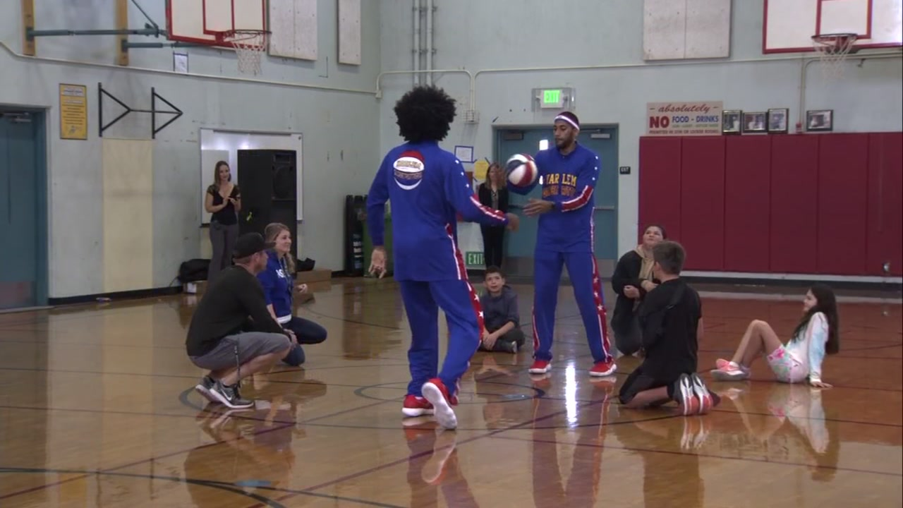 Two Globetrotters deliver an anti-bullying message to students at a Pleasant HIll, Calif. school on Wednesday, Oct. 10, 2018.