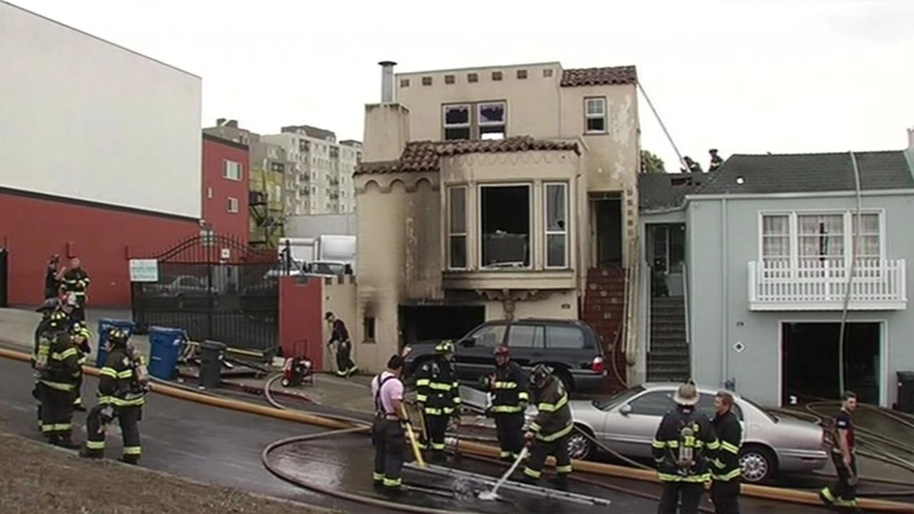 Fire crews put out a multi-alarm fire on Knowles Avenue in Daly City, Calif., on Thursday, October 1, 2015.