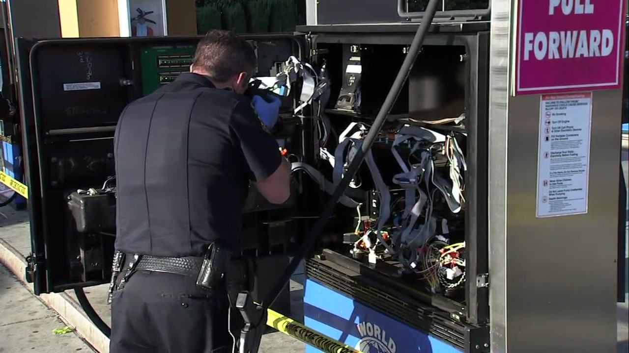 Police examine gas station pumps that were broken into in Sunnyvale, California on Friday, October 12, 2018.