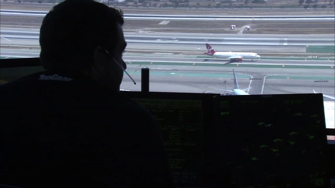 An air traffic controller surveys a runway.