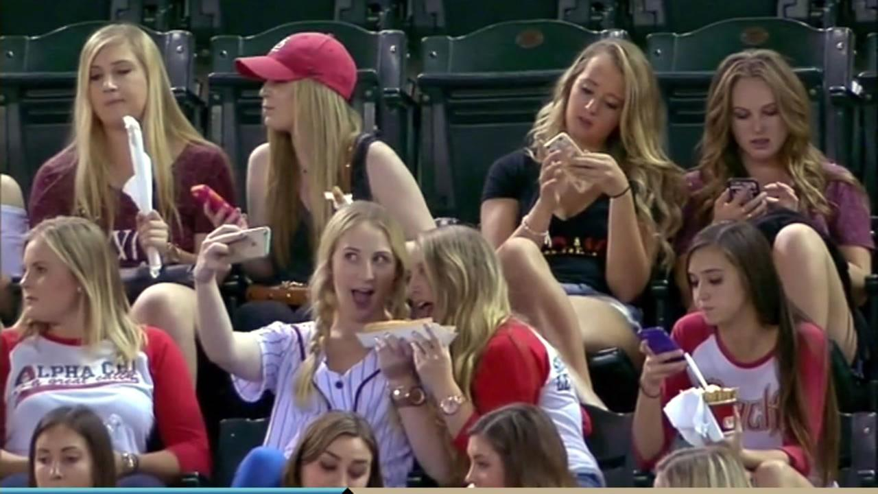 A cameraman at an Arizona Diamondbacks game captured a group of sorority girls who were apparently more interested in snapping the perfect selfie than watching the game.