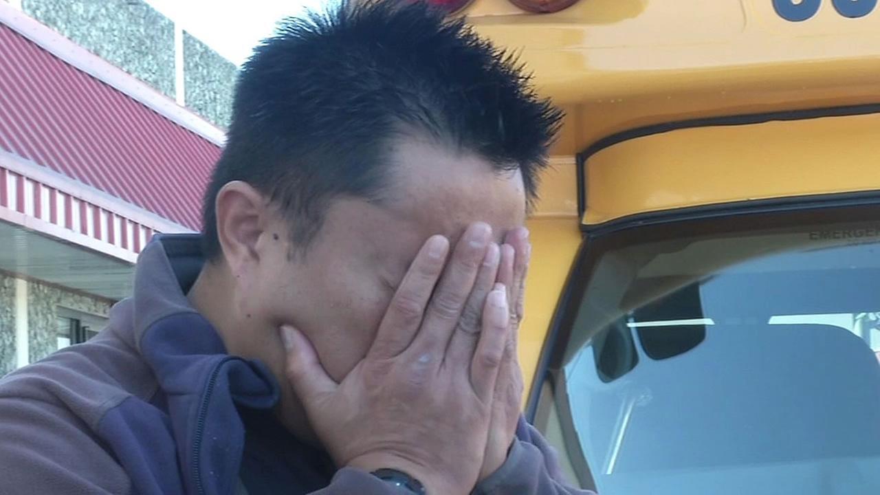 Jason Santos buries his head in his hands