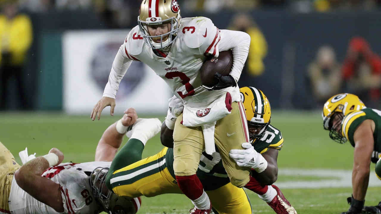San Francisco 49ers quarterback C.J. Beathard (3) is sacked by Green Bay Packers nose tackle Kenny Clark (97) during an NFL football game Monday, Oct. 15, 2018, in Green Bay, Wis.