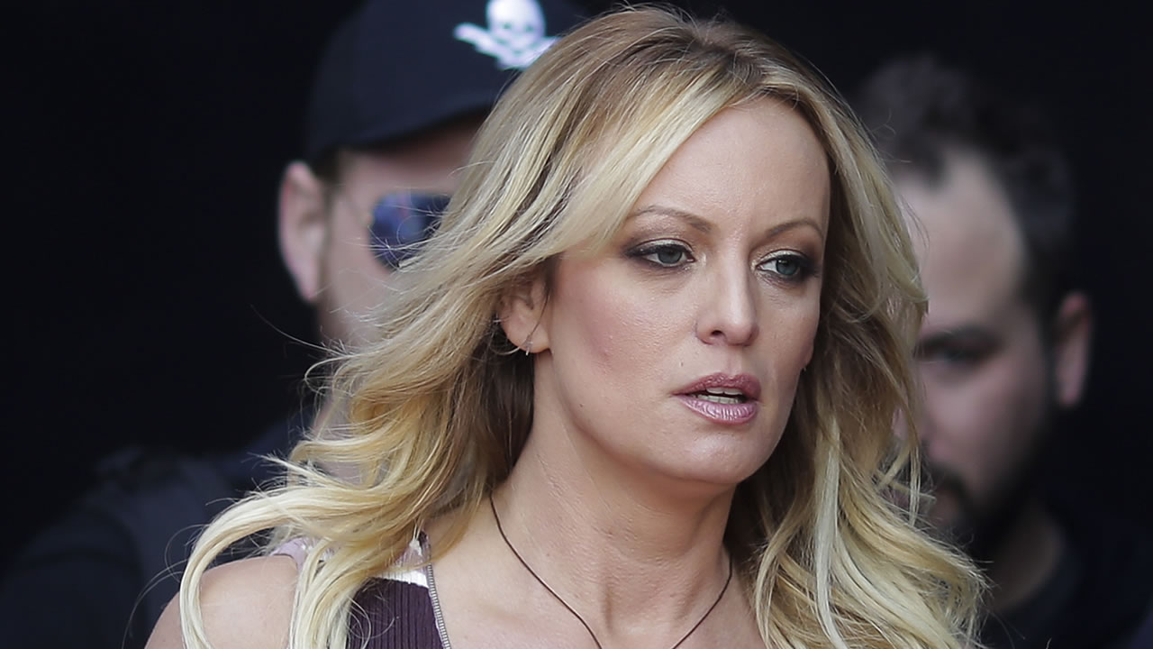 In this Thursday, Oct. 11, 2018, file photo, adult film actress Stormy Daniels arrives for the opening of the adult entertainment fair Venus, in Berlin.