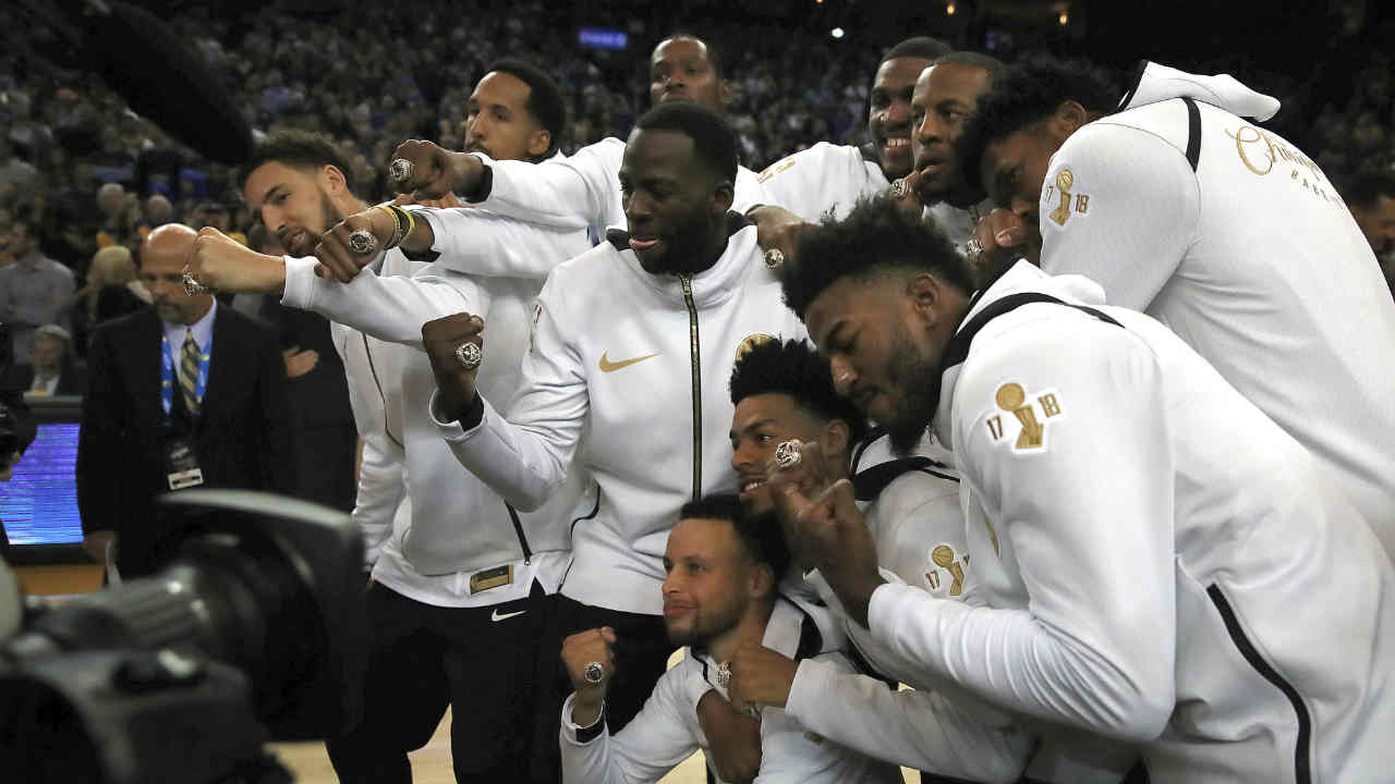 The Golden State Warriors celebrate after receiving their championship rings after a ceremony to recognize the teams NBA championship on Tuesday, Oct. 16, 2018, in Oakland, Calif.