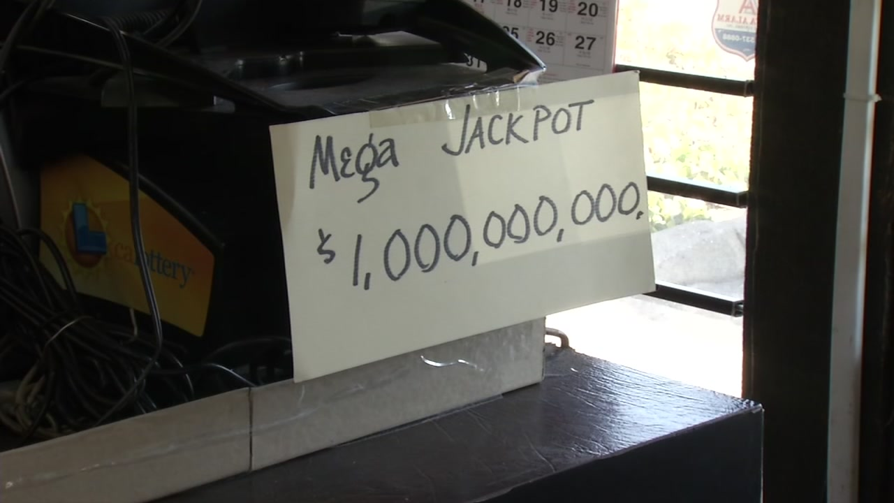 A homemade sign at a liquor store in San Jose, Calif. shows the Mega Millions jackpot at $1 billion on Friday, Oct. 19, 2018.