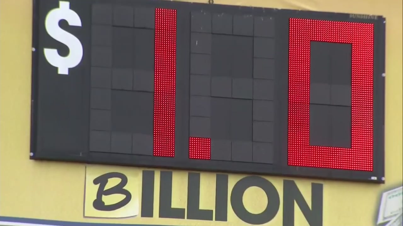Mega Millions sign shows $1 billion prize.