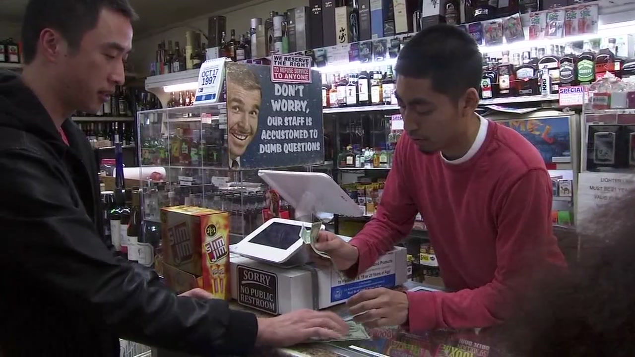 A man buys lottery tickets at 19th Avenue Liquors in San Francisco on Oct. 20, 2018.