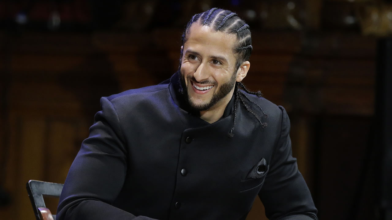 Former NFL football quarterback Colin Kaepernick is seated on stage during W.E.B. Du Bois Medal ceremonies, Thursday, Oct. 11, 2018, at Harvard University, in Cambridge, Mass.