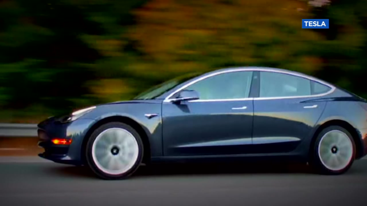 A Tesla is pictured in an advertisement.