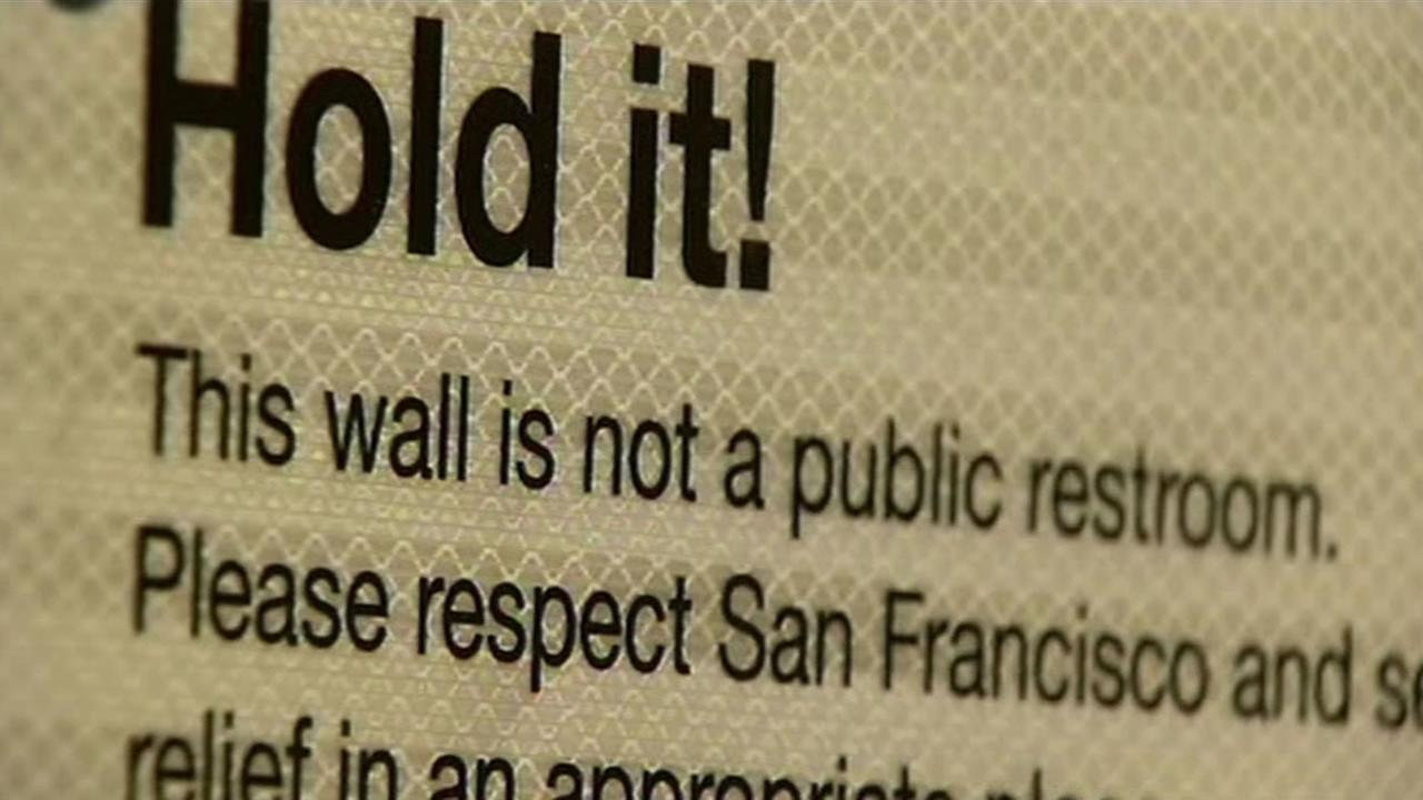 This sign was posted next to a wall that was coated with a urine repellent in San Francisco on Wednesday, October 7, 2015.