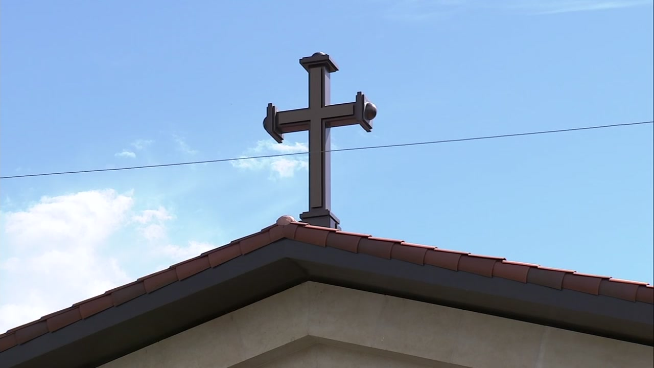 A cross is pictured atop a Catholic church.