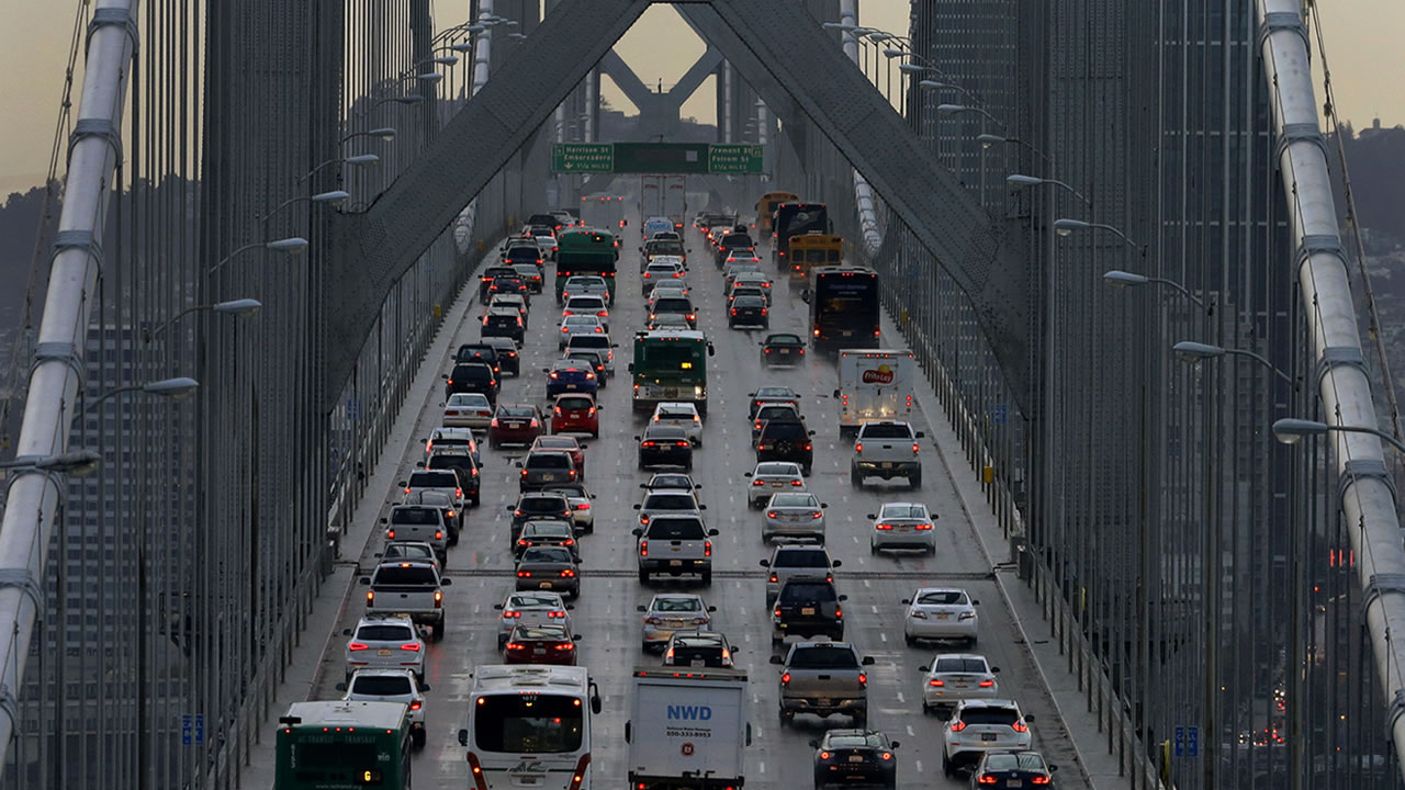 In this Dec. 10, 2015 file photo, vehicles make their way westbound on Interstate 80 across the San Francisco-Oakland Bay Bridge as seen from Treasure Island in San Francisco.