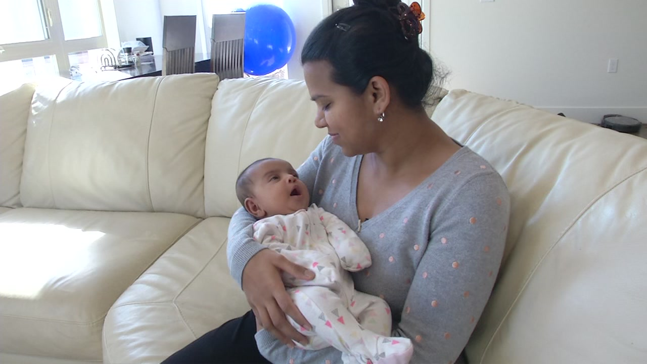 Shania Shah holds her new baby in Milpitas, Calif.