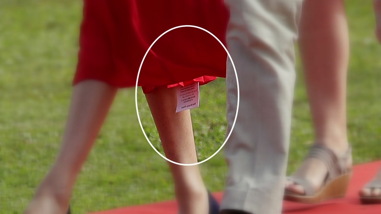 The Duchess of Sussex was spotted wearing a beautiful new red dress-- there was only one problem. Her tag is showing.