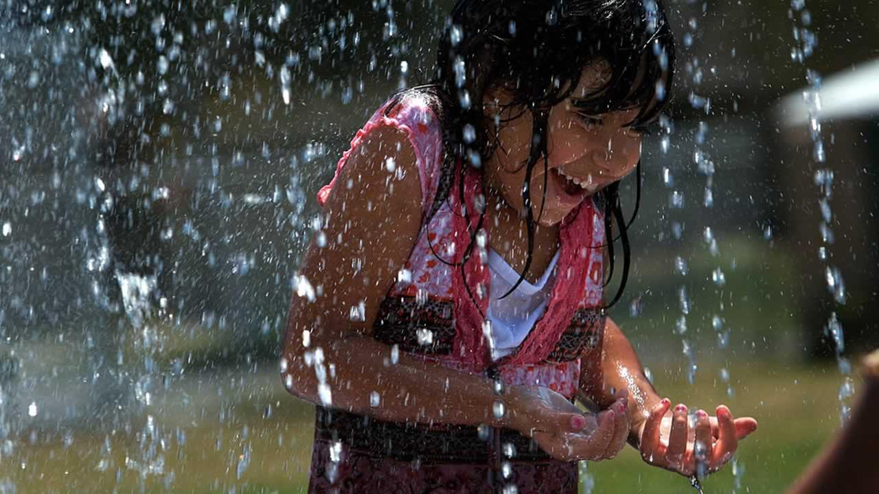 Veronica Manso, 7, enjoys the cool water from the fountain at the Almaden Library Community Center in San Jose, Calif., Wednesday, June 21, 2006. (AP Photo/John Stubler)