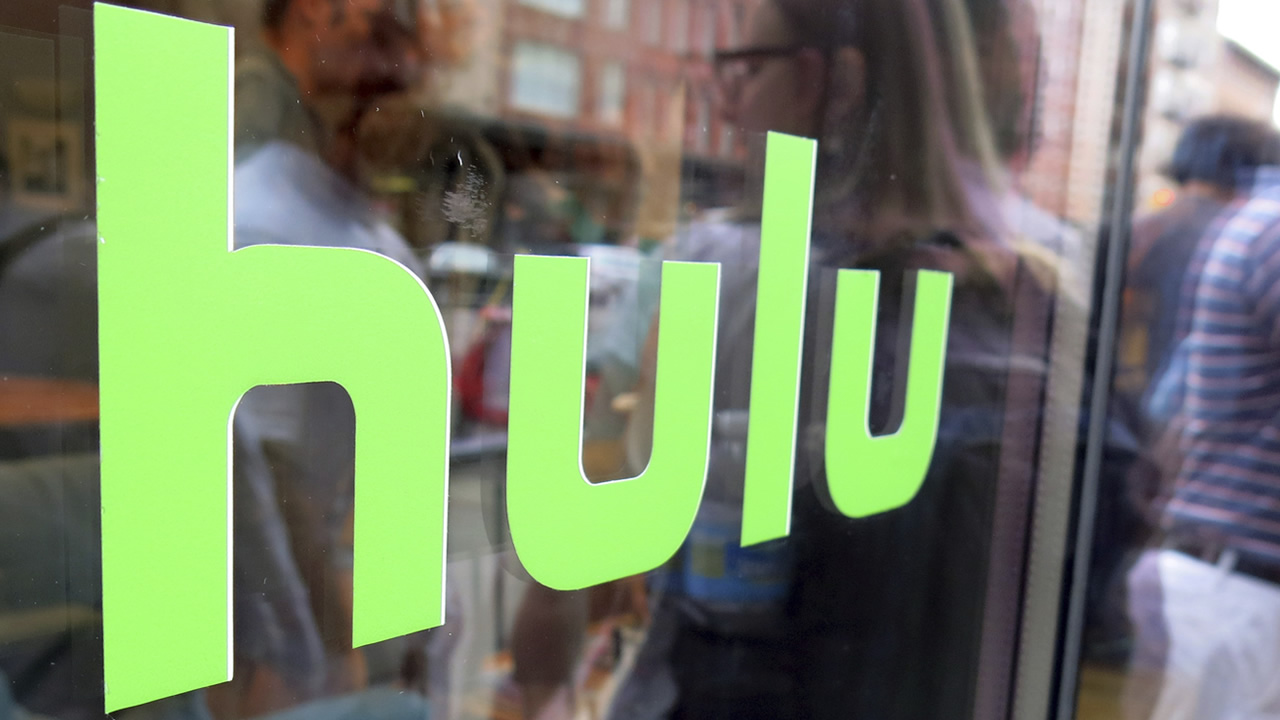 This June 27, 2015, file photo, shows the Hulu logo on a window at the Milk Studios space in New York.
