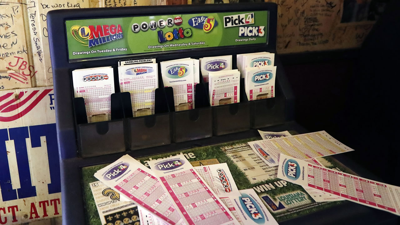 Lottery forms for Louisiana Mega Millions, Powerball and other lottery games fill the drawer at The World Bar and Grill, in Delta, La., on Oct. 23, 2018.