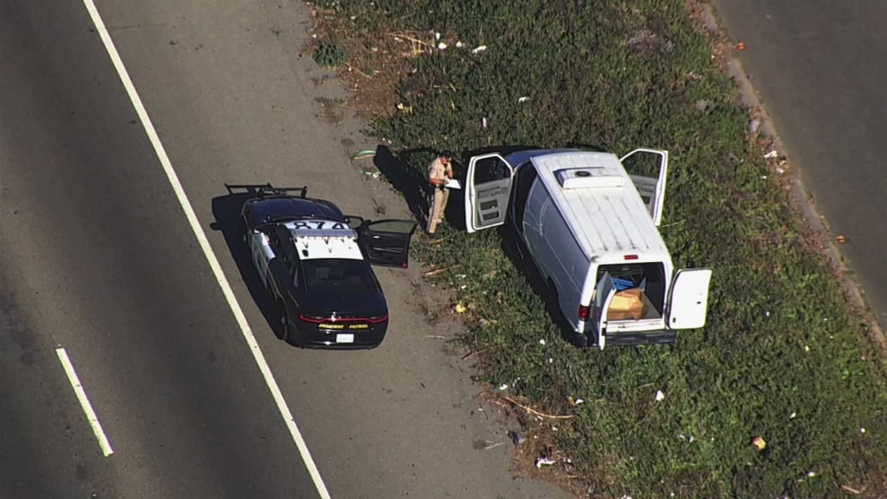 Police inspect van on I-880 in Oakland, California on Tuesday, October 30, 2018.