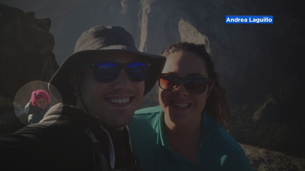 A San Bruno woman taking a photo with her boyfriend in Yosemite also captured a woman with pink hair-- the same woman park officials said fell to her death along with her husband.