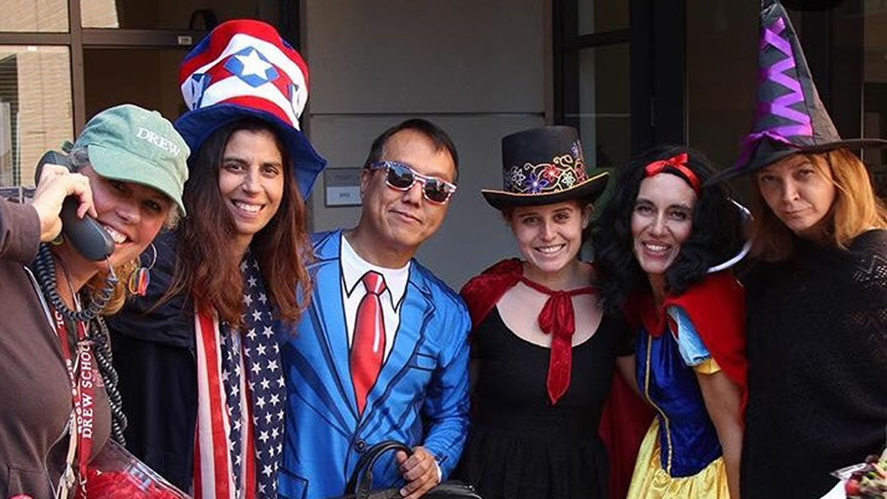Students pose for a photo in their Halloween costumes in San Francisco on Wednesday, Oct. 31, 2018.