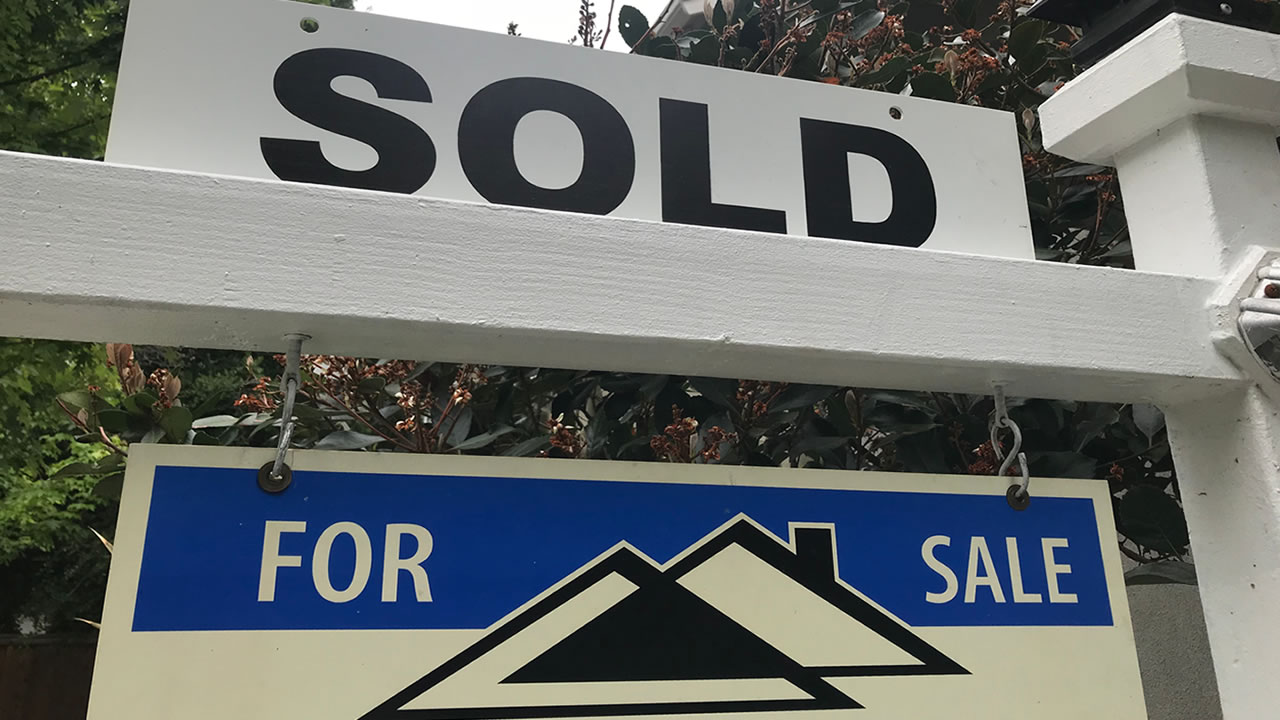 A sold sign is posted in front of a home in this undated file photo.