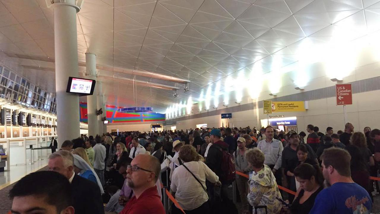 In this photo provided by Ashley Hopkins, people wait in lines at Dallas-Fort Worth Airport in Dallas, Wednesday, Oct. 14, 2015.