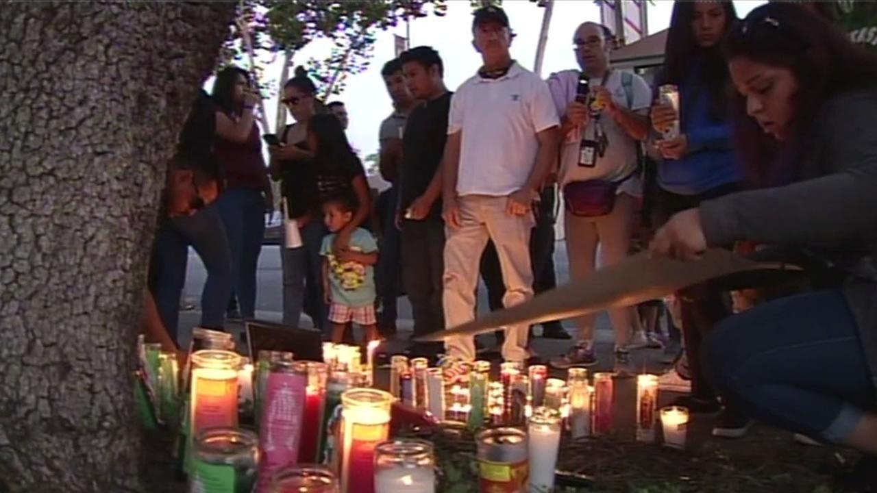 Family and friends of three teens killed in a car crash gathered in San Jose and held vigil at the spot where they died, Oct. 14 2015.