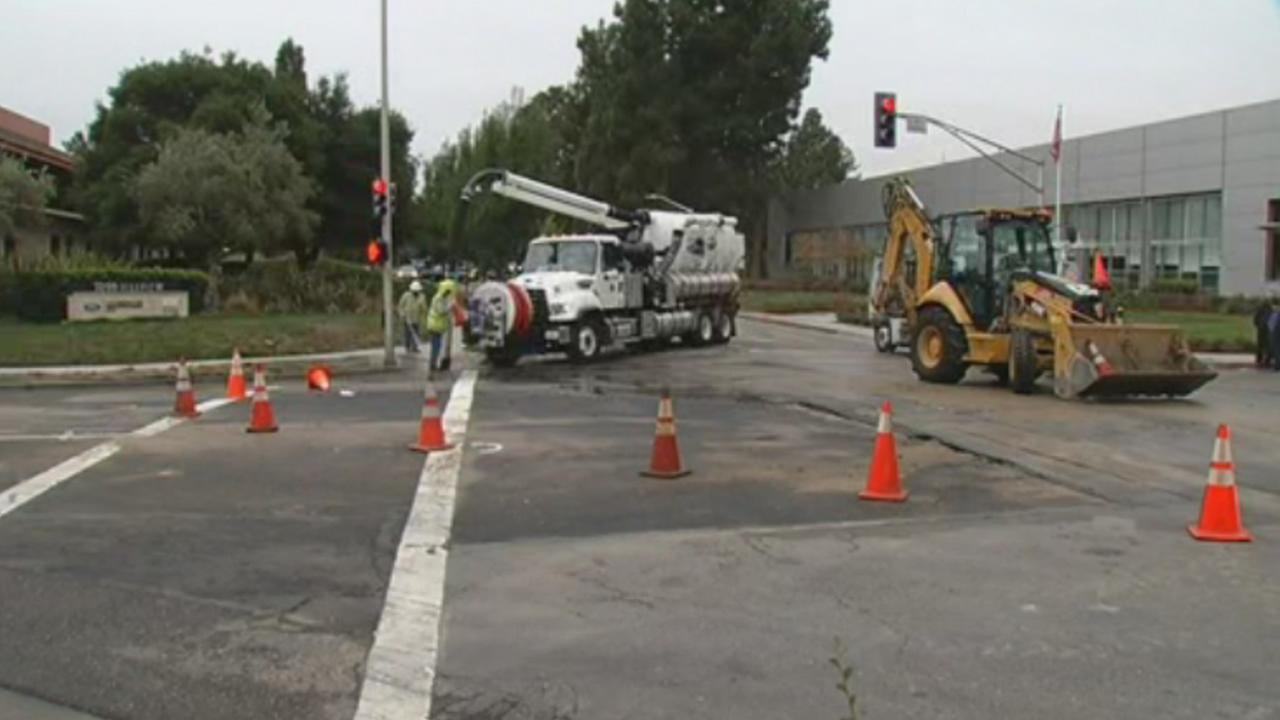 Crews work to repair a water main break at Hillview Avenue and Hanover Street in Palo Alto, Calif., on Friday, October 16, 2915.