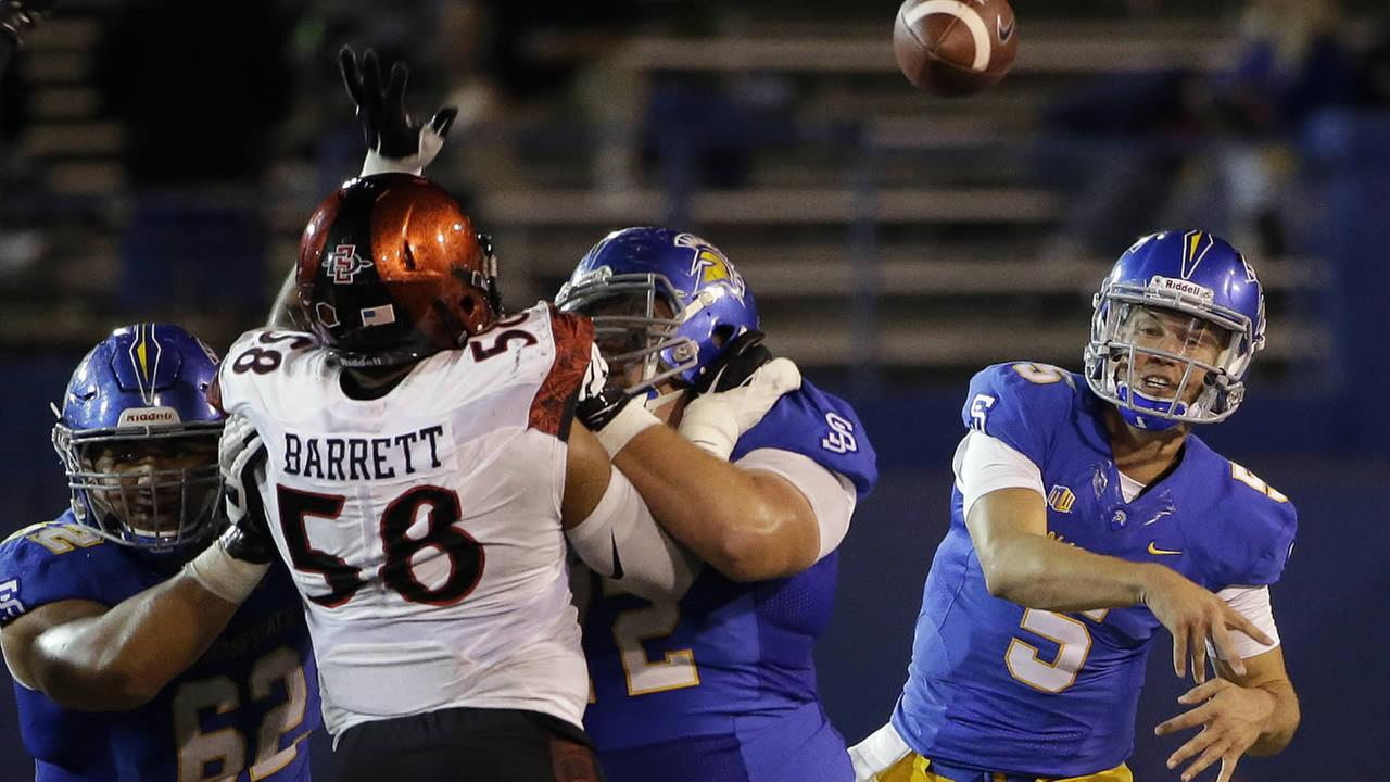 San Jose State quarterback Kenny Potter throws a pass against San Diego State during a  football game on Saturday, Oct. 17, 2015, in San Jose, Calif.