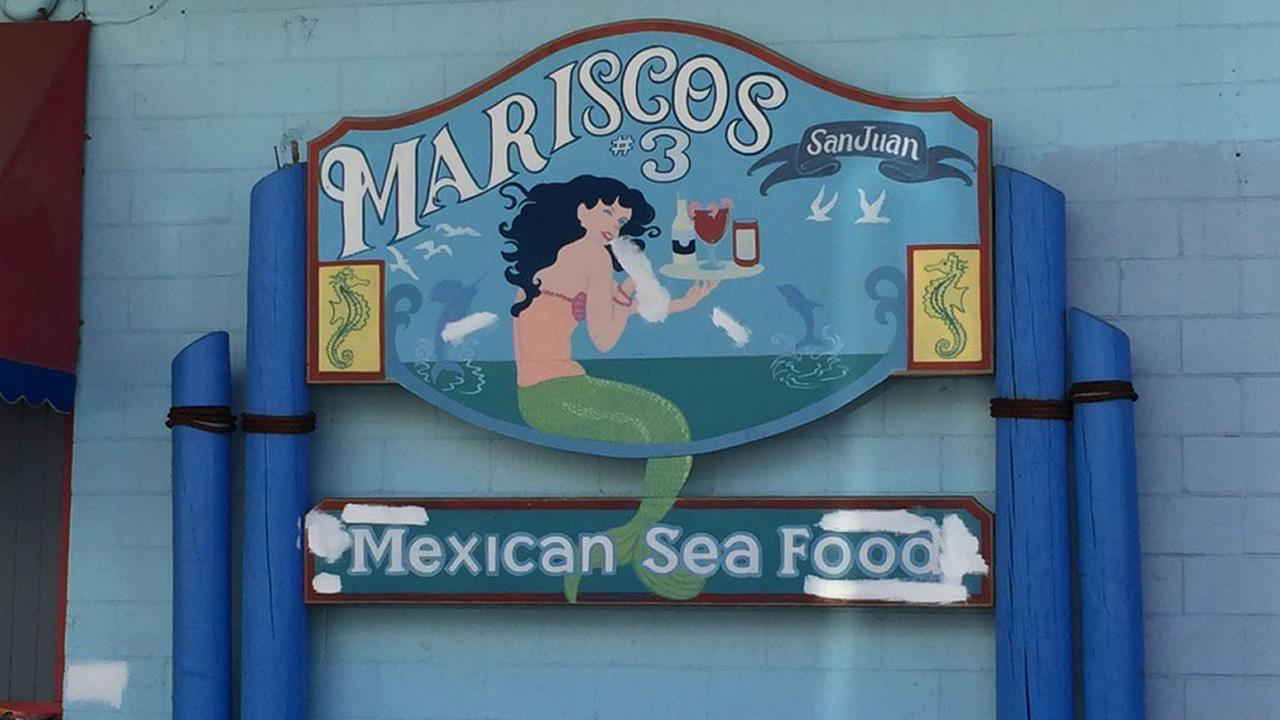 A sign for Mariscos San Juan #3 restaurant in San Jose, Calif. is seen on October 21, 2015. Officials are investigating after a Shigella outbreak was linked to the eatery.