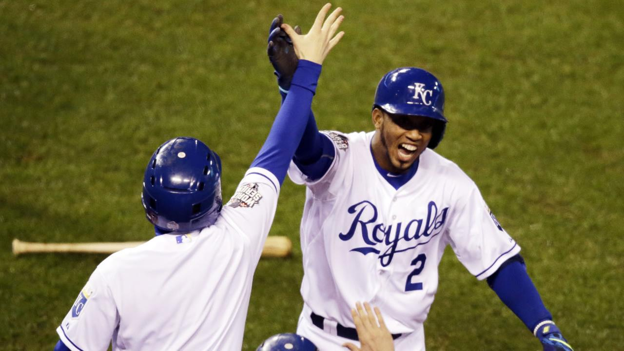 Kansas City Royals Alcides Escobar celebrates after hitting an inside-the-park home run during the first inning of Game 1 of the Major League Baseball World Series.