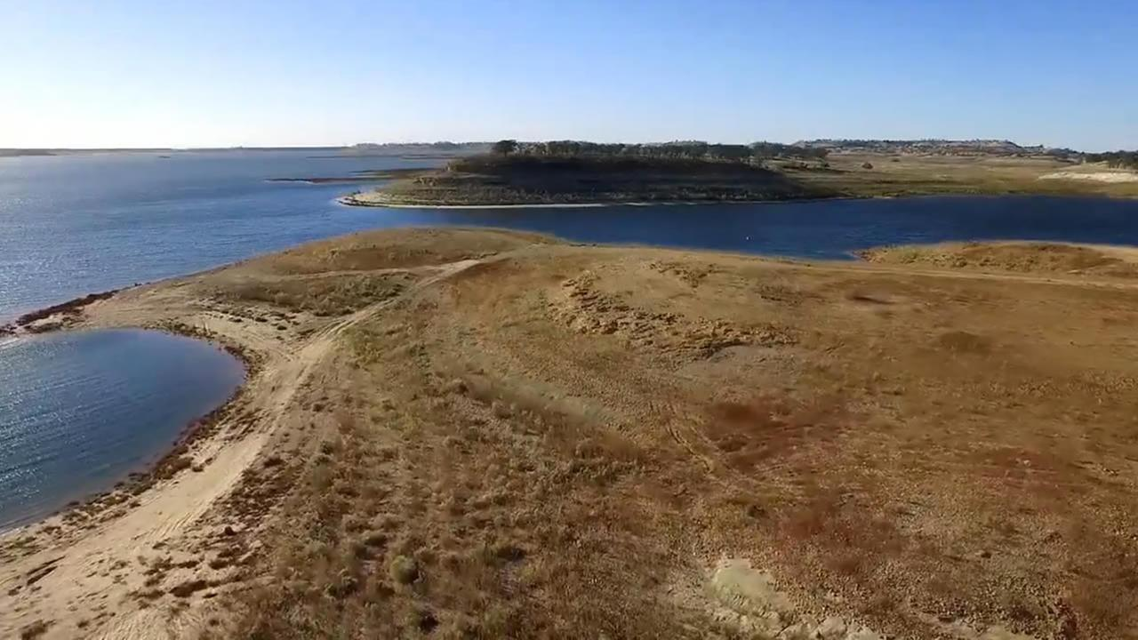 This image taken from DroneView7 shows a parched Camanche Reservoir near Stockton, Calif. on Thursday, October 29, 2015.
