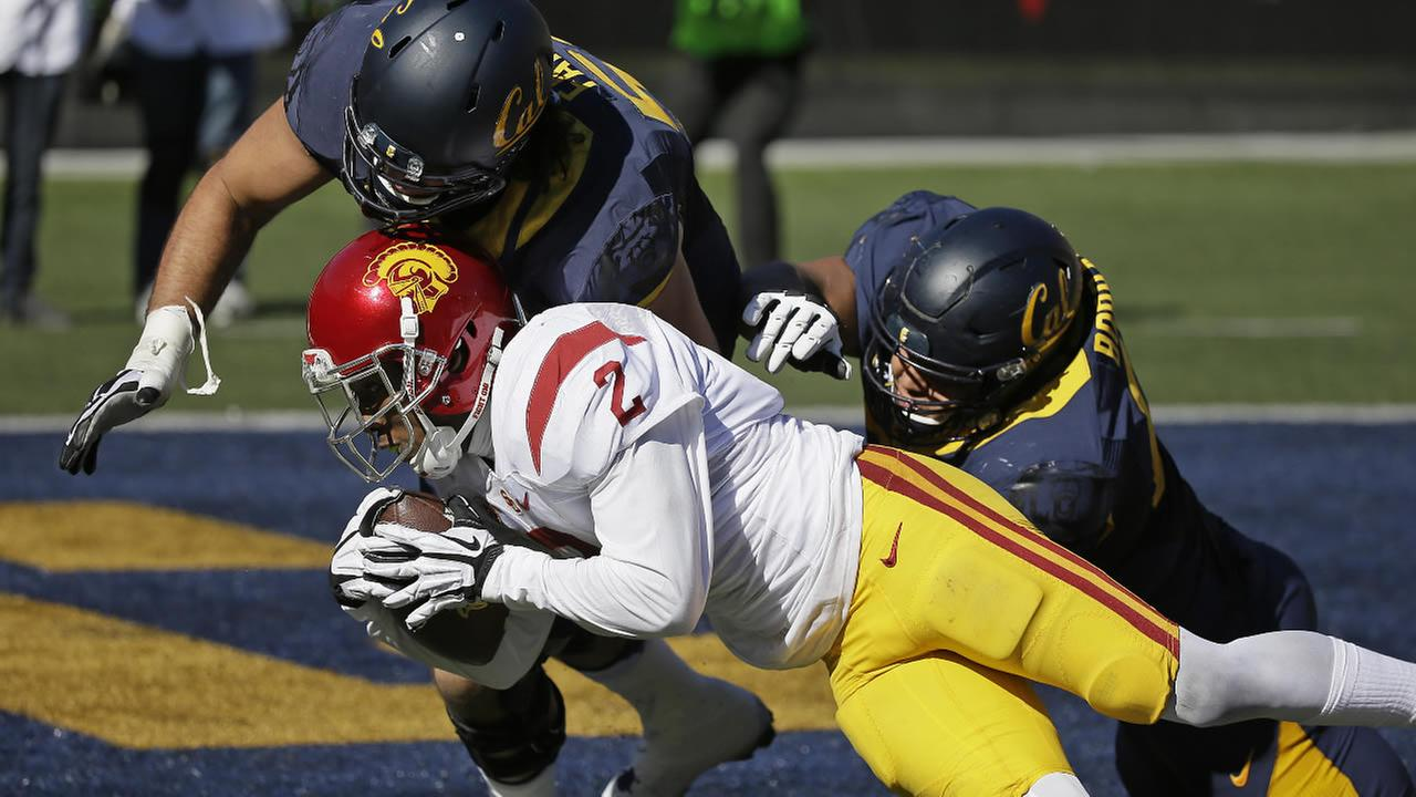 Southern California cornerback Adoree Jackson scores a touchdown after making a 46-yard interception against California, Saturday, Oct. 31, 2015, in Berkeley, Calif.