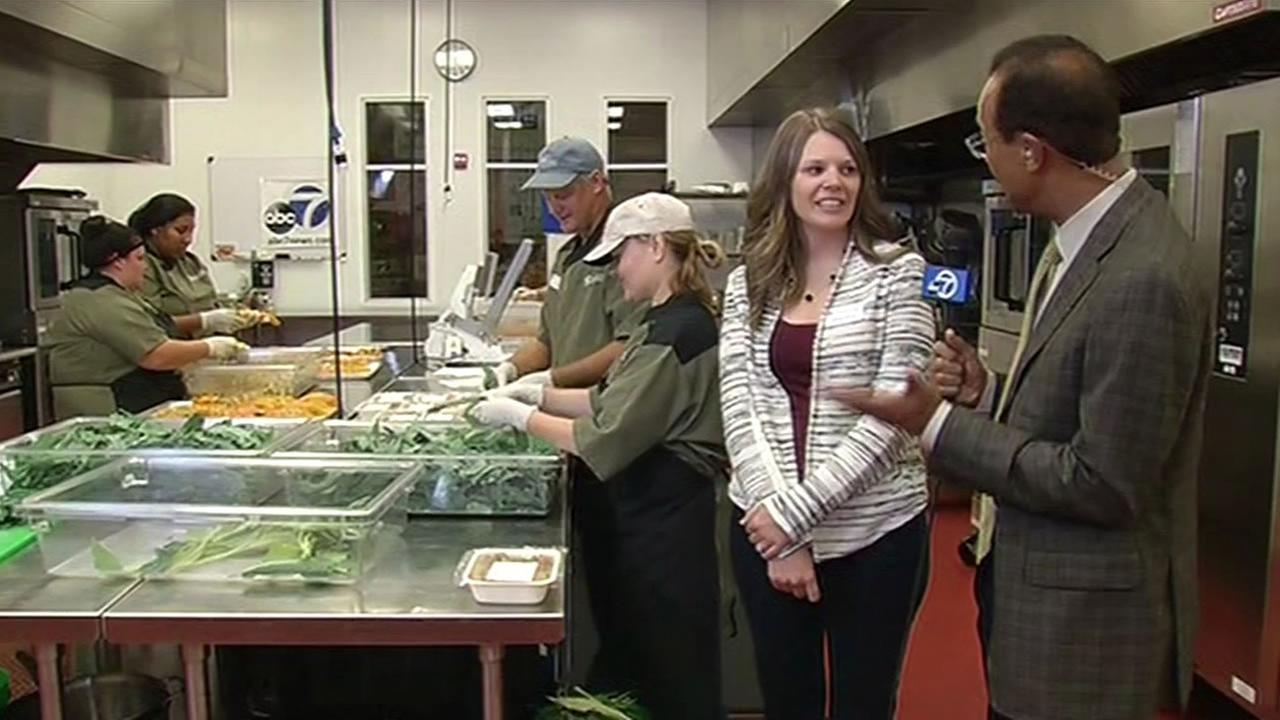 ABC7 Weather Anchor Spencer Christian and Redwood Empire Food Bank Development Officer Hillary Jarcik are seen at the nonprofit in Santa Rosa, Calif. on Monday, November 2, 2015.